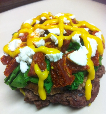 I like to load'er up with a steamed portabello cap, steamed spinach, light goat cheese, sundried tomatoes, mustard and tabasco