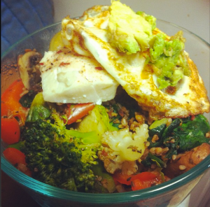 Lots of green veggies sauteed with mushrooms, red pepper, bulgar, garlic, onion, tons of basil, chili flakes and powder ALL TOPPED With a small leftover piece of haddock, a fried whole egg and some avocado