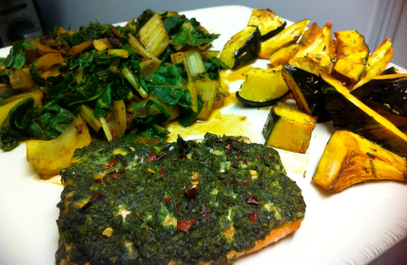 Slab of steelhead trout baked with my freshly homemade basil pesto (oil free) and chili flakes. Side of swiss chard/mushroom saute and rosemary roasted acorn and kabocha squashes