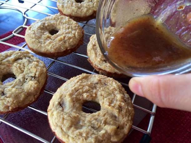 Carefully drizzle-whizzle your caramel syrup over the pronuts while they are warm.