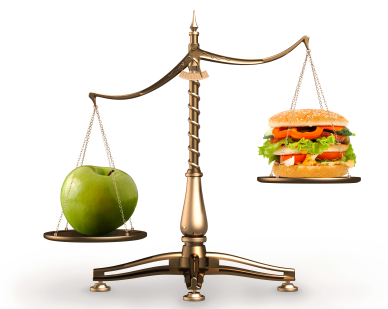 Apple and hamburger on scales conceptual